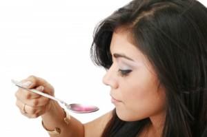 ill girl taking medicine