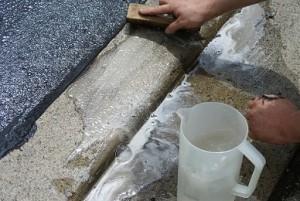 cleaning asphalt sealant leak on driveway