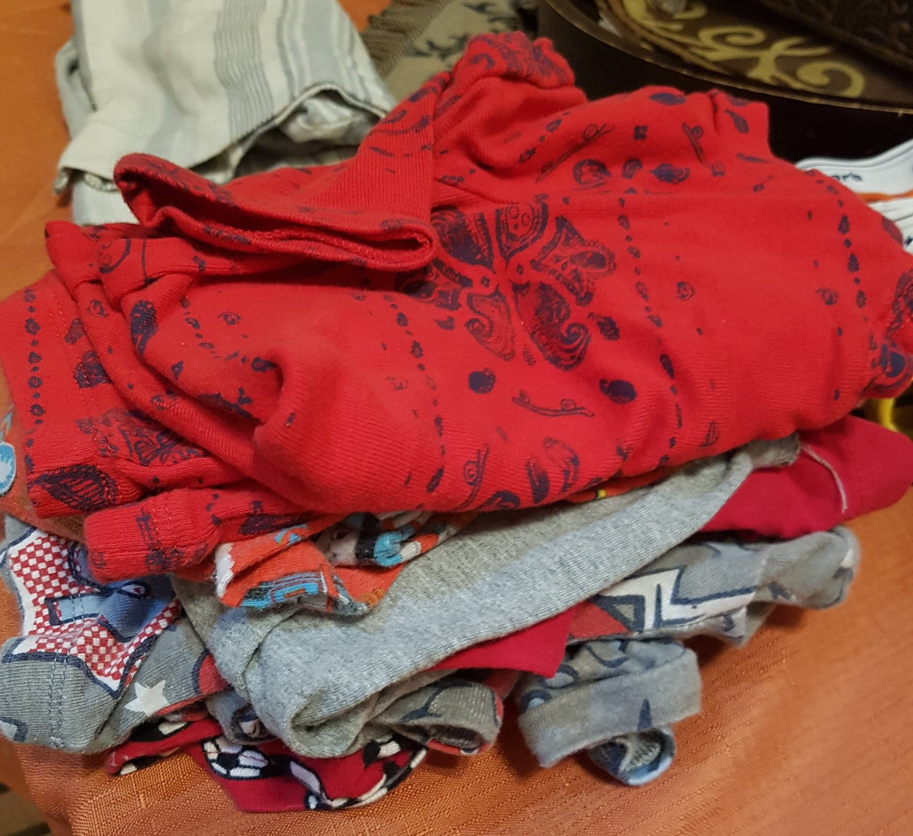 folded children's clothes for sale