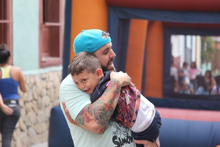 Man Hugging a Boy