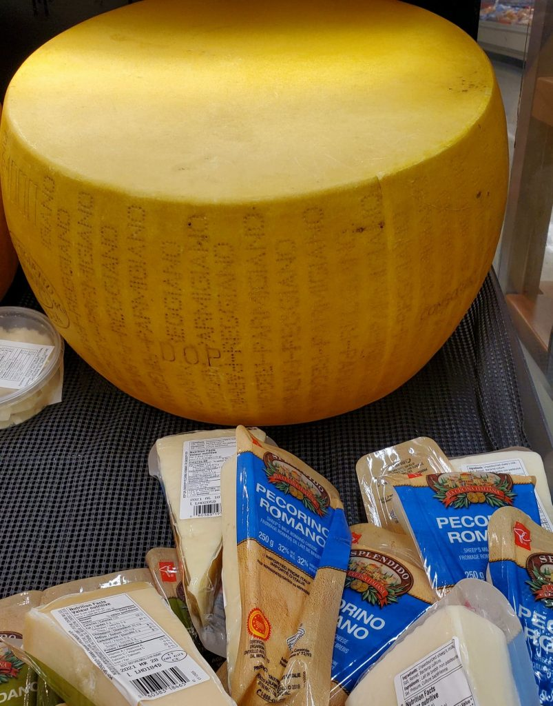 Reggiano Parmigiano Cheese Wheel with Romano Cheese Wedges