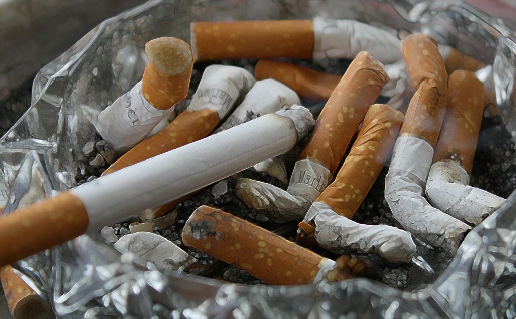 Ashtray full of cigarette butts inside of a home. Smoking in your home will reduce your home value. Do not smoke indoors and increase home value. A fresh clean home is ideal when selling to maximize on home value.