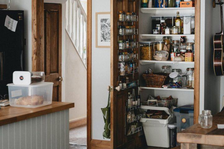 Stocked kitchen pantry doors open