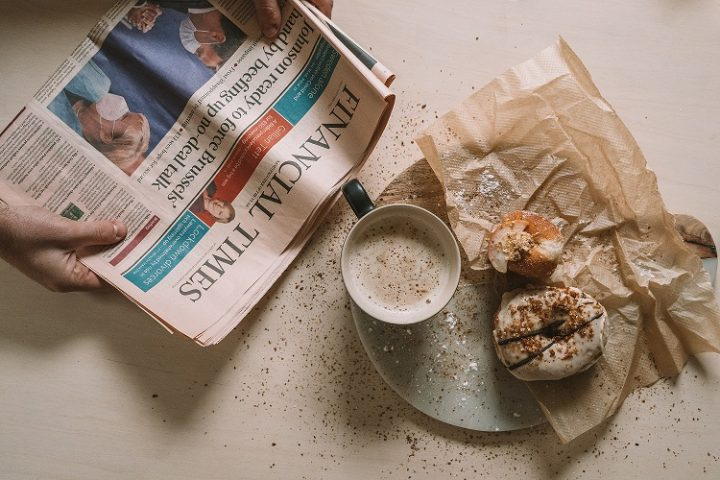 Take a break to read the news and enjoy a cup of coffee and a pastry.