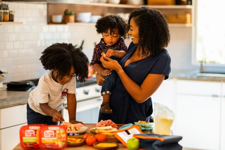 Kids helping mom in the kitchen preparing school lunch ideas